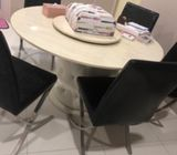 Round dining table with 5 dining chairs