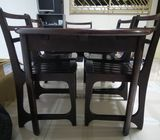 Used solid wood dining table and chairs